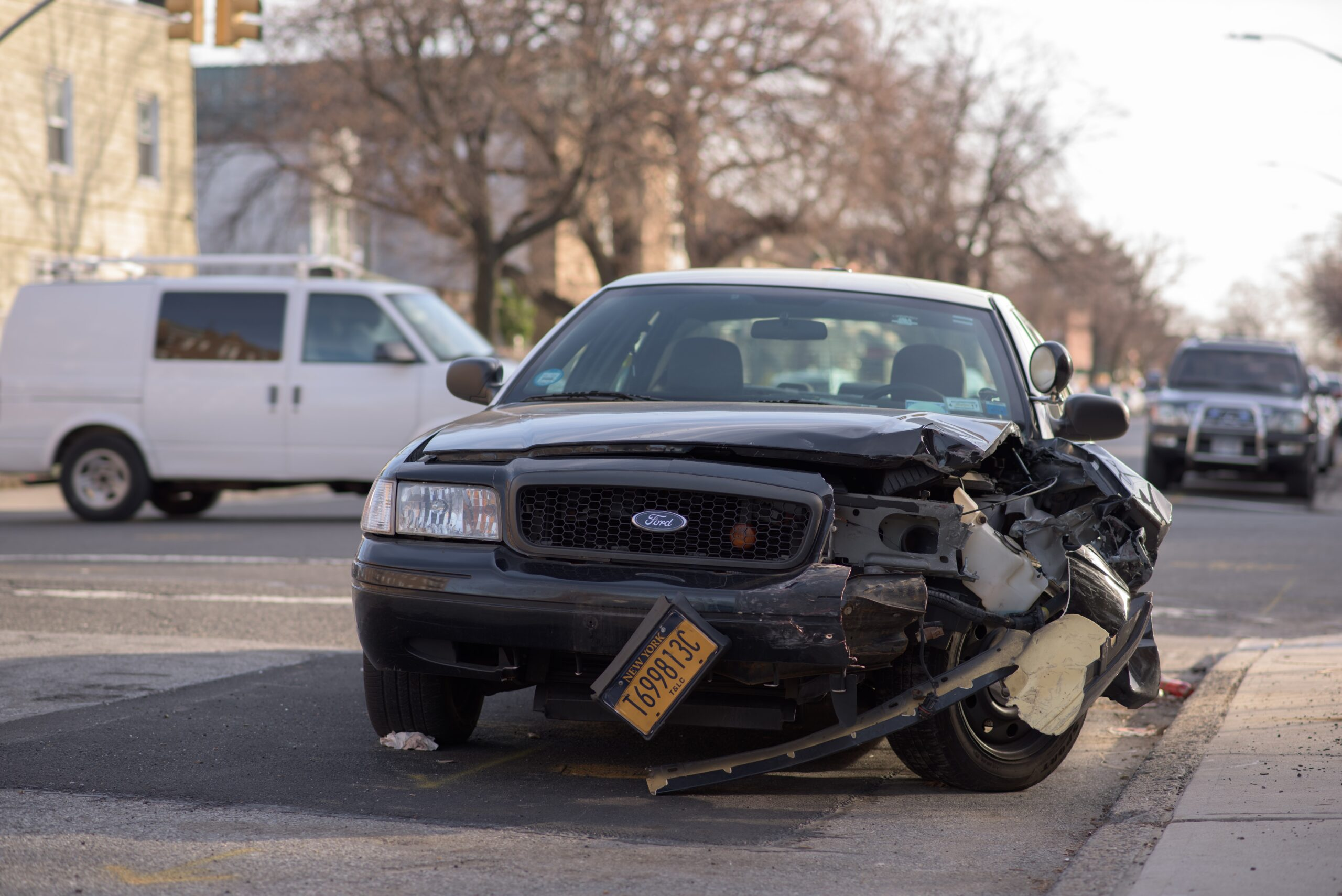 A black car damaged due to an accident
